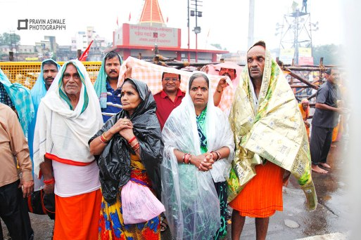 Devotees with Rain covers