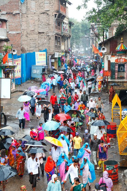 An ally in Nashik filled by people w ith colourfull Umbrellas and rain covers!