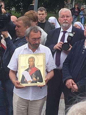 Сергей Иванович Котькало с иконой святаго праведнаго Феодора Ушакова у гроба новопреставленного