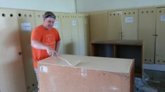 Painting classroom cabinets (Roma School in Kosice).
