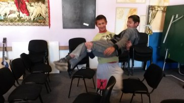 """Fuzzy photo - a couple of weeks ago, one of our study topics was helping each other in our weakness. The boys had to figure out how to get their """"wounded"""" teammates through an obstacle course."""