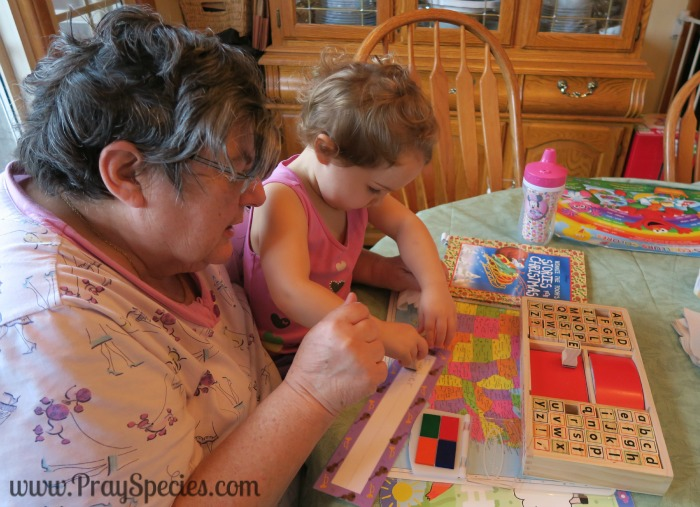 ladybug getting help from grandma in stamping her name