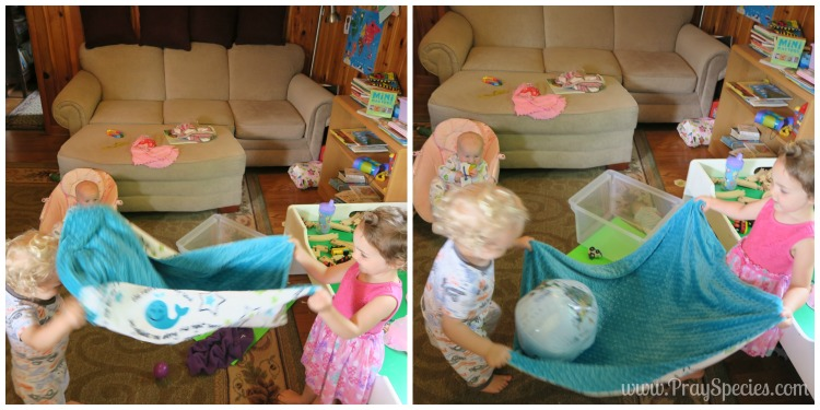 Look how fascinated my sweet little baby is in the background :) Home School / Baby Entertainment :)