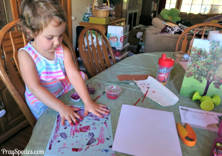 MGT ladybug painting with hands