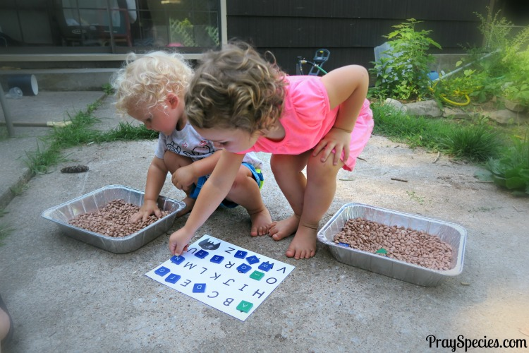 kids-digging-for-letter-tiles-in-the-dirt