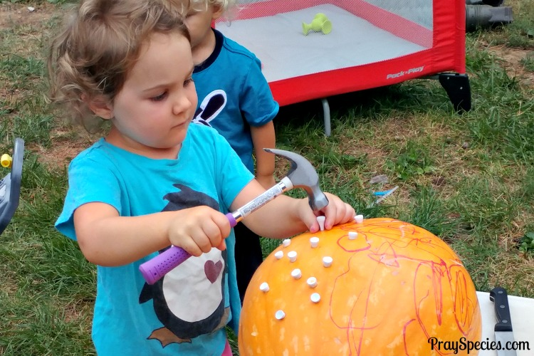 working-on-her-pumpkin-ladybug