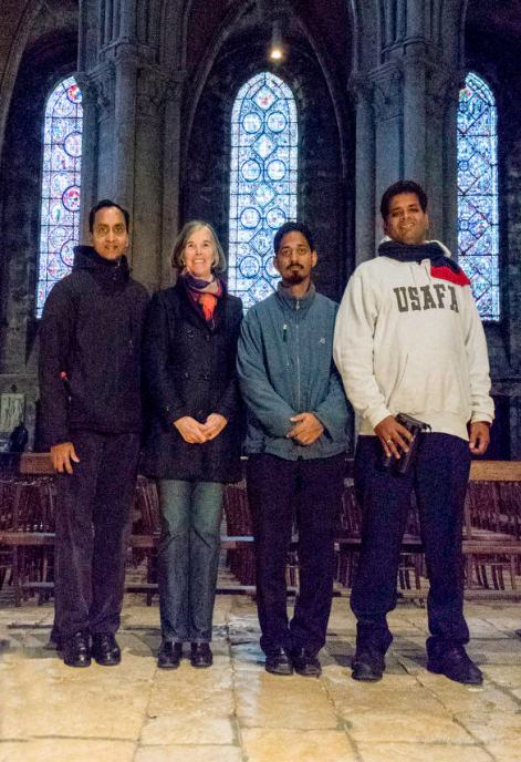 First-time visitors to the cathedral visit and pray with Jill Geoffrion