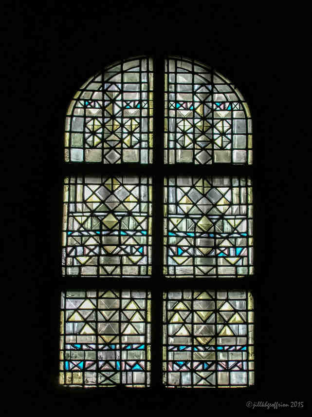 Modern stained glass window in the south ambulatory of the crypt