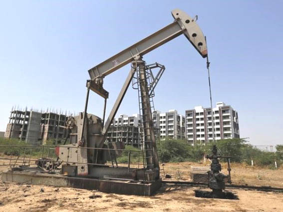 Oil prices drop as China cuts economic growth target