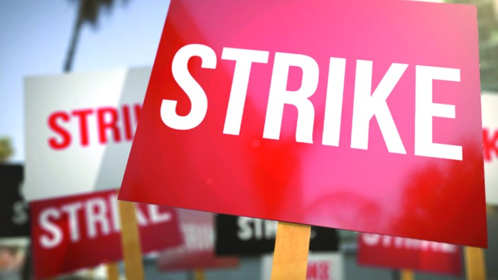 Information Dept employees go on strike, demand revocation of officer's suspension