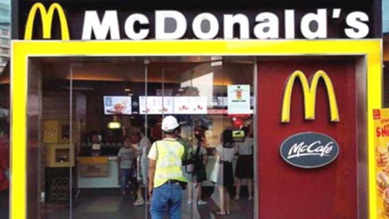 McDonald's buys out partner, will temporarily shut 165 outlets