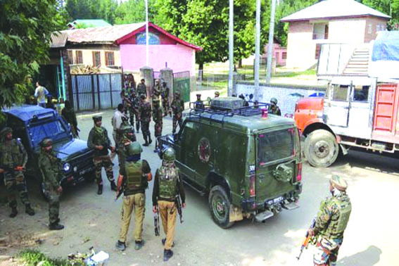 Teenager falls off bike after forces open fire in air, held in Anantnag