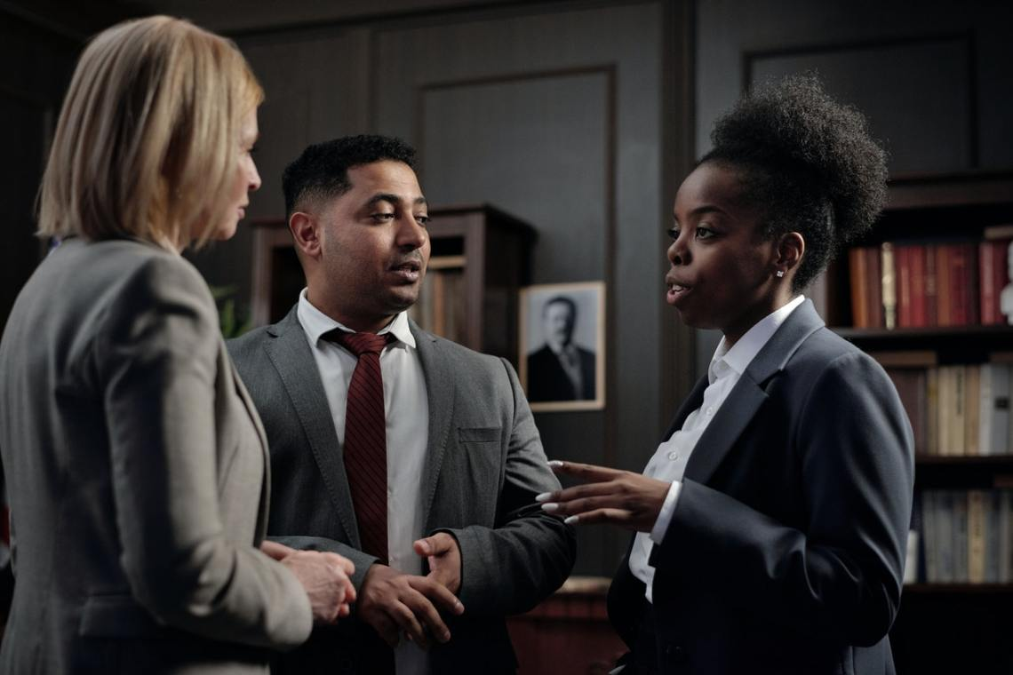 image of black woman boss talking to her team