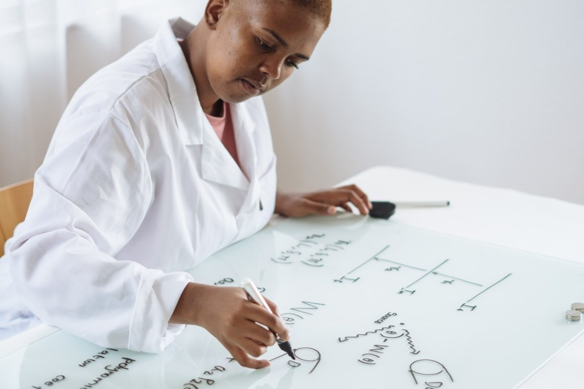 image of woman looking at calculations