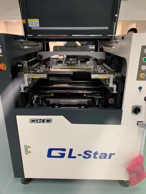 an SMT Screen Printer with door opened