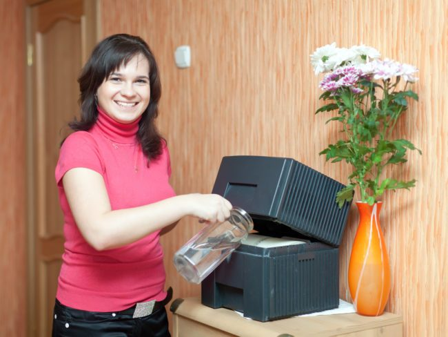 Woman changing humidifier water panel