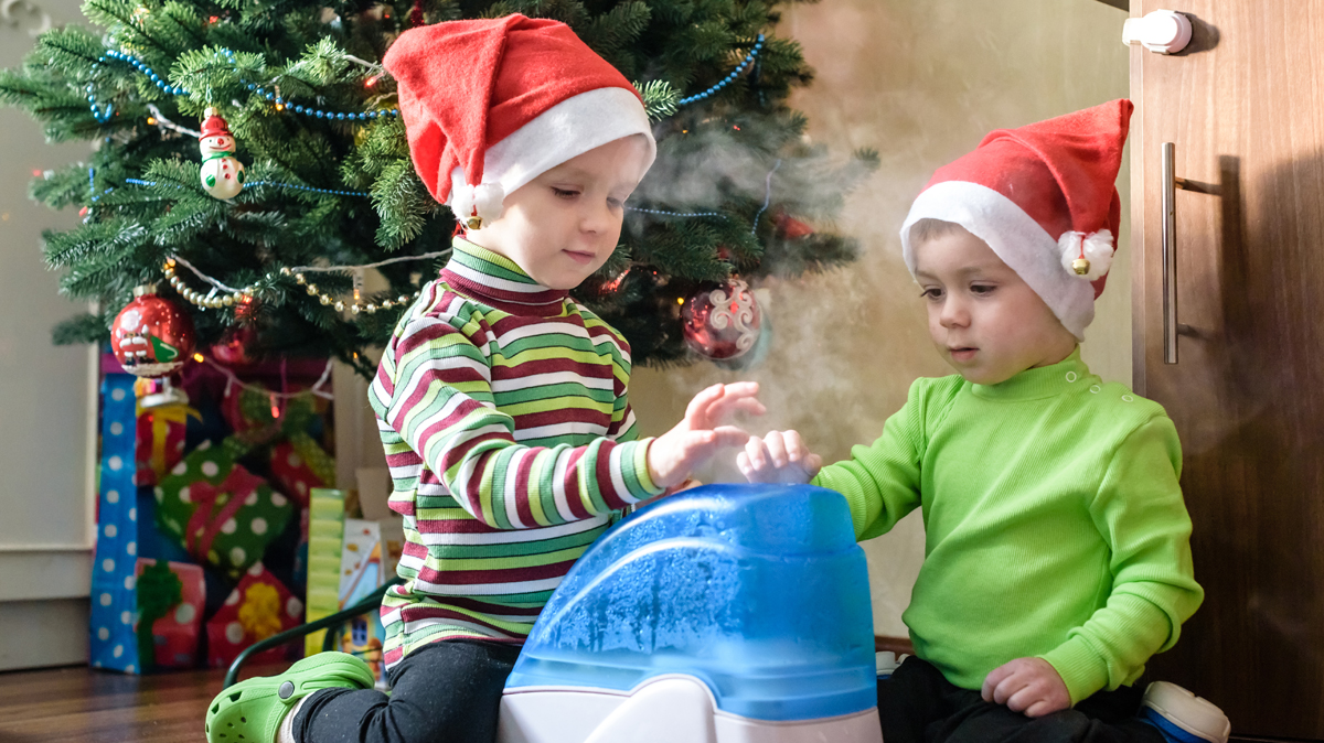 Children playing with humidifier