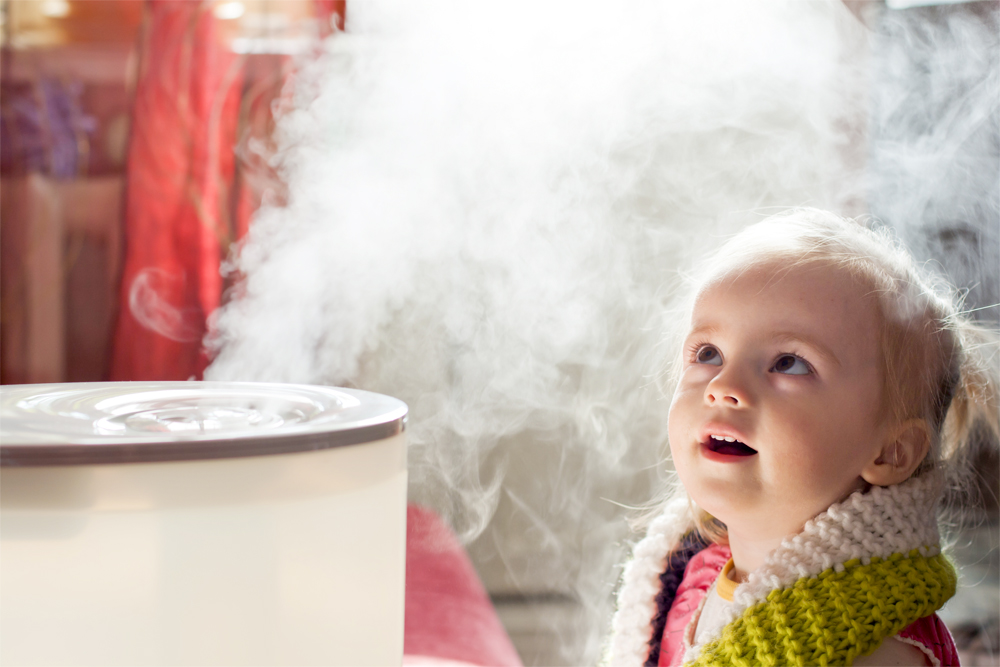 little girl learning to how to use a humidifier
