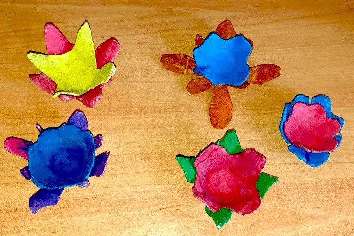 Easy egg carton craft flower for kids. Step 3. Glue the egg carton flowers together to create the flower petals.