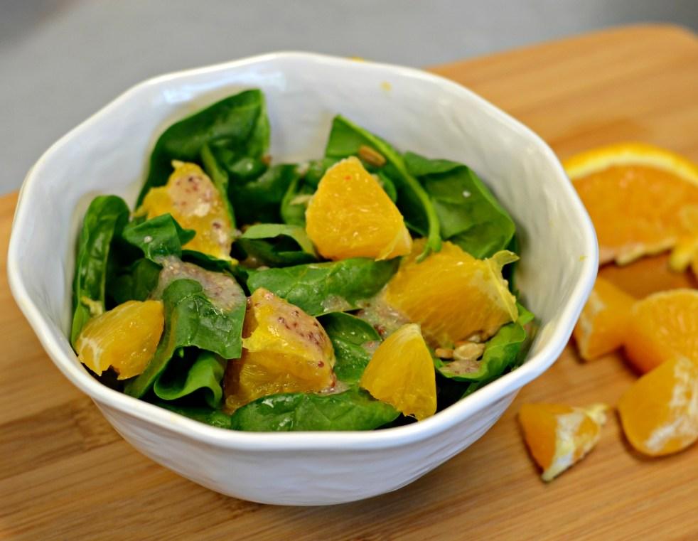 iron, vitamin C, orange slices, spinach salad