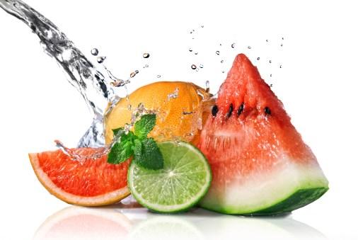 Water splash on fresh fruits isolated on white background