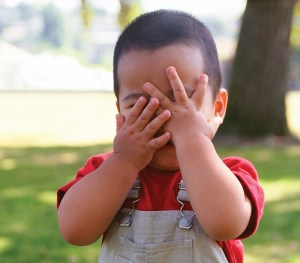 Toddler covering their eyes