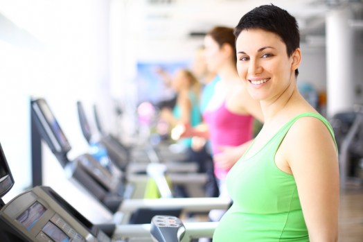 Expectant parent walking on treadmill