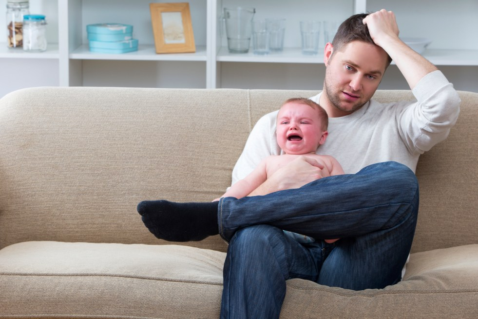 Dad holding crying baby