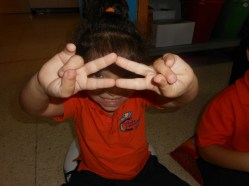 Cecilia made a triangle with her finger
