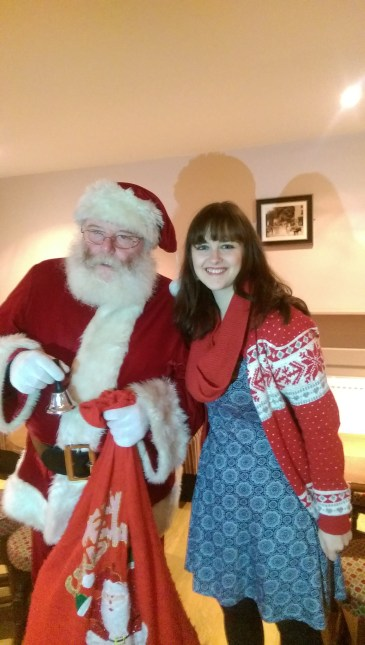 Image 1: Myself with Santa at my running groups Christmas party.