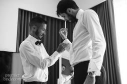 Best man helps groom prepare