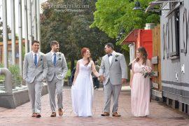 Bridal party walking down the shores of Philadelphia