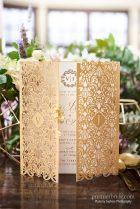 Elaborate, laser cut gold gate fold invitation