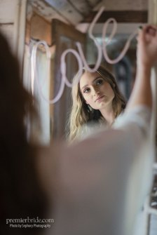 Bride writes Love in lipstick on the mirror