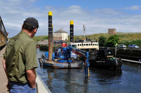 Dredging in Eyemouth Harbour on Saturday 5th July.