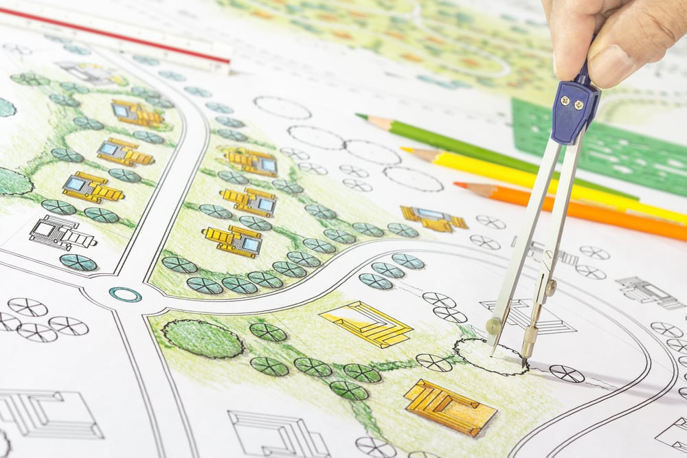 Landscape designer planning the landscape of a residential community.