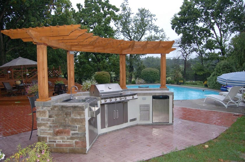 An Outdoor Kitchen for Your Gulf Coast Backyard - Premier ... on Outdoor Kitchen With Pool Ideas id=84502