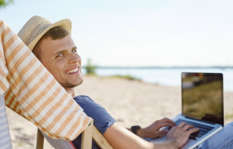 laptop at the beach 1024x659 - Your Path to Becoming a TEFL Digital Nomad