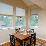 Modern dining room with rug