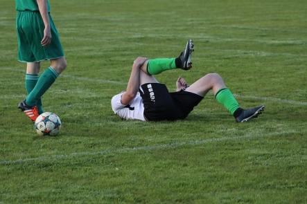 sports injuries - soccer player holding injured knee