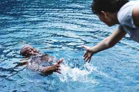 Drowning Dangers - Man Being Pulled from Water before Drowning