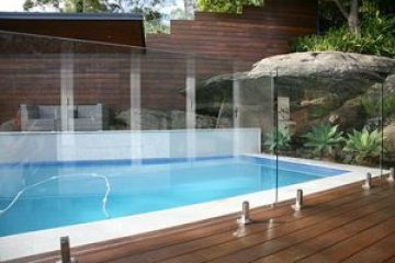Frameless Glass pool fencing on timber decking.