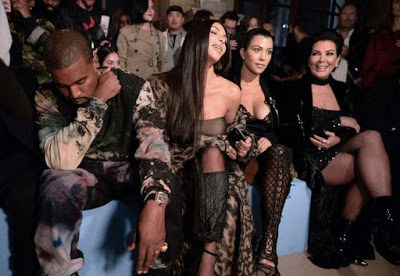 Kim Kardashian slips into bizarre boob tube and trouser ensemble while Kourtney is seriously sexy in lingerie look