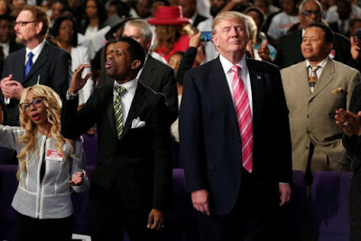 Republican presidential nominee Donald Trump attends a church service, in Detroit, Michigan, U.S., September 3, 2016.