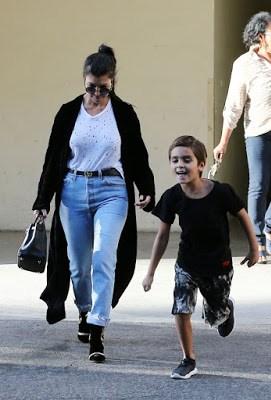 Kourtney-Kardashian-steps-up-her-secretary-team-with-a-personal-bodyguard-as-she-picks-up-her-son-Ma
