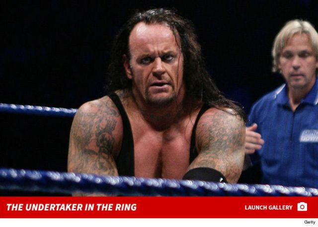 WWE Legend Undertaker surfaces in 'American gun' shirt