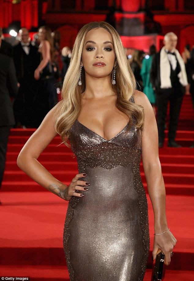 Rita Ora looks sexy in figure hugging metallic dress at the Fashion Awards 2017