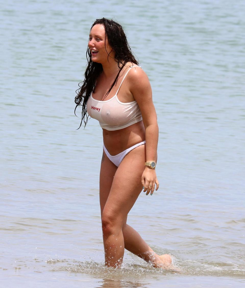 Charlotte Crosby flashes her boobs in a wet T-shirt .1
