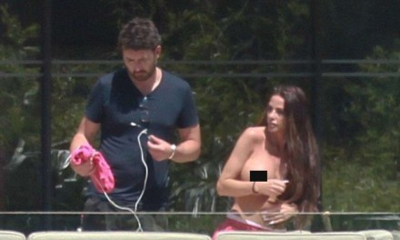 Katie Price goes topless as she soaks up the sun with male pal in Portugal