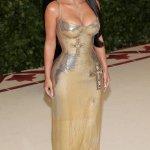 Kim Kardashian attends the 2018 Met Gala wearing sexy gold versace dress